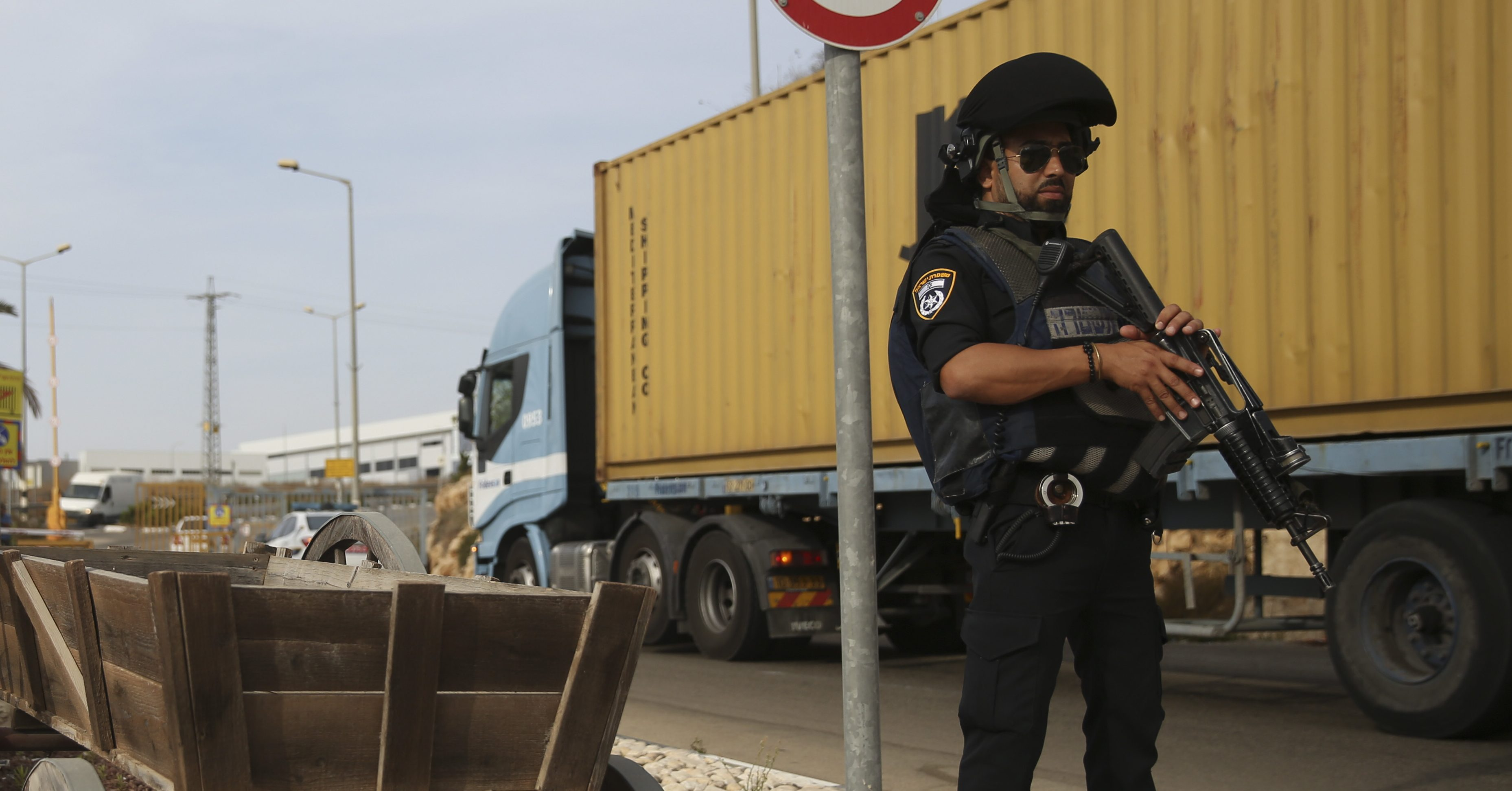 Israeli policemen stand at the entrance of Barkan industrial zone in the West Bank