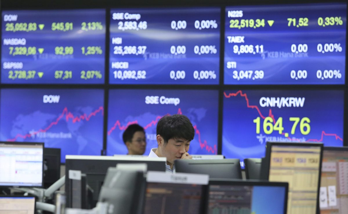 A currency trader watches monitors at the foreign exchange dealing room of the KEB Hana Bank headquarters in Seoul, South Korea, Friday, Oct. 12, 2018. Asian stocks were mixed on Friday as better-than-expected Chinese trade data gave some markets a breather from worries about the impact of punitive tariffs.