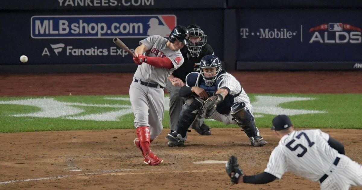 Boston's Brock Holt connects for a two-run triple against the New York Yankees during Game 3 of the American League Division Series, Monday in New York.
