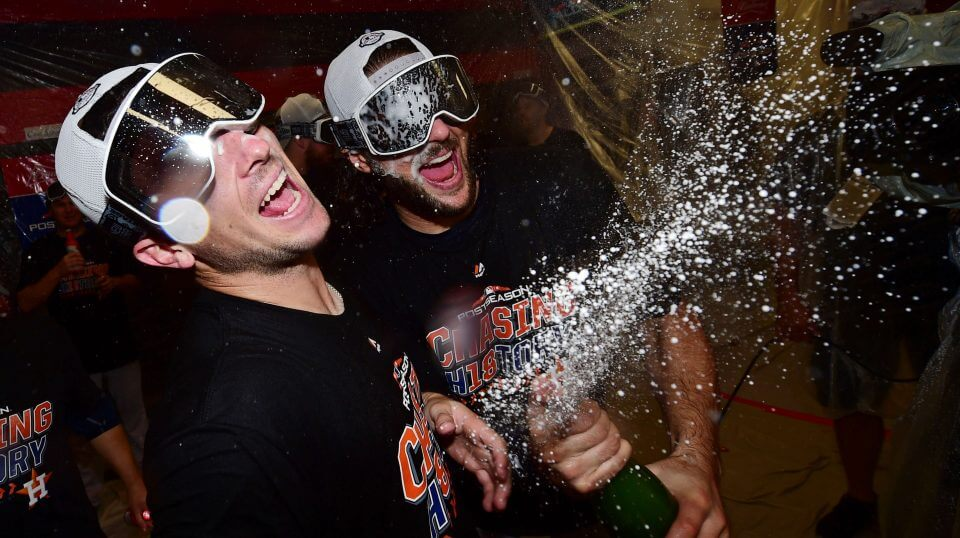 Houston Astros' Alex Bregman, left, and Jake Marisnick celebrate after defeating the Cleveland Indians 11-3 in Game 3 of the American League Division Series.