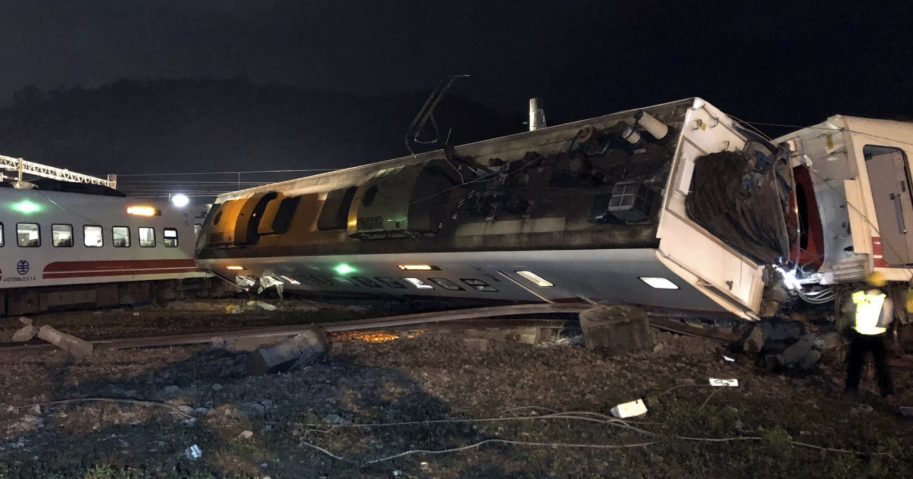 Train carriages are scattered at the site of a train derailment in Lian in northern Taiwan