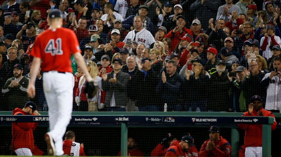 Fans cheers as Boston Red Sox starting pitcher Chris Sale leaves the game against the New York Yankees during the sixth inning of Game 1 of the American League Division Series on Friday in Boston.