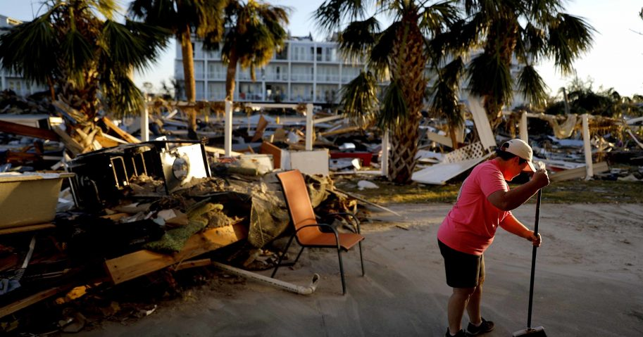 Peggy Cauley cleans up debris from her family's home in the aftermath of hurricane Michael