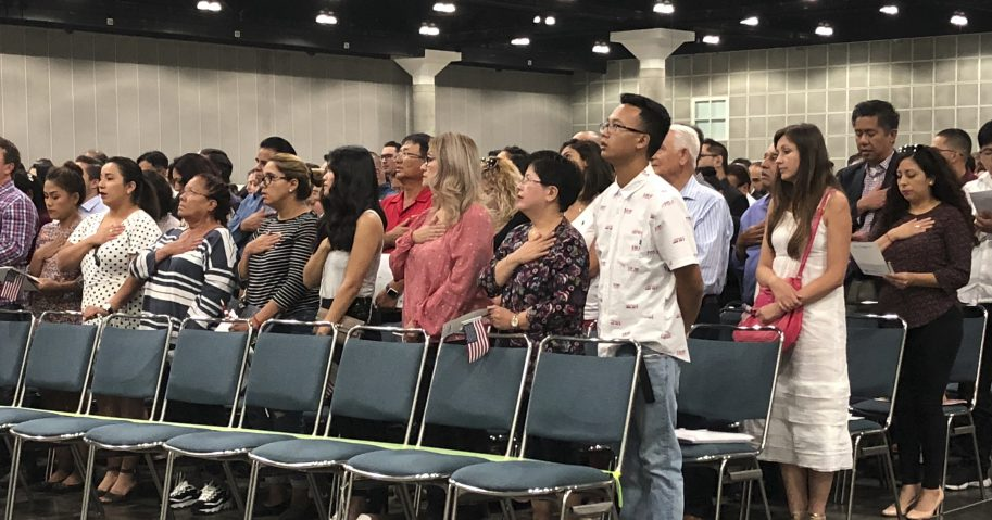 New American citizens stand during a naturalization ceremony in Los Angeles