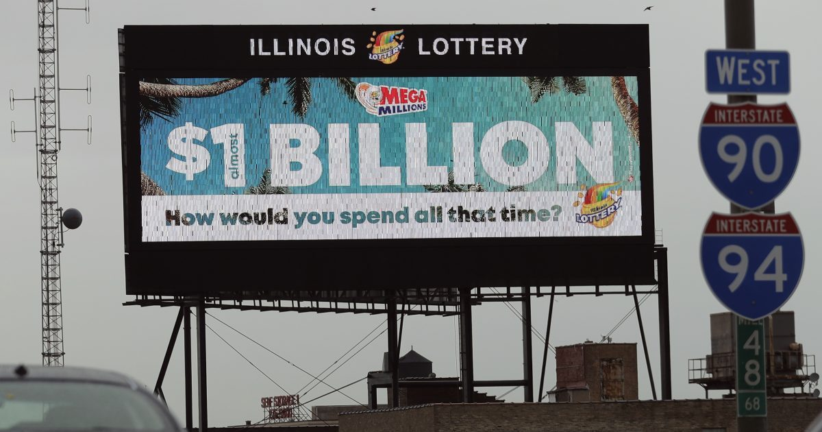 A digital billboard along I-90/94 highway in Chicago displays the estimated Mega Millions jackpot, Oct. 19, 2018. Friday's jackpot has soared to $1 billion, the second-largest prize in U. S. lottery history.