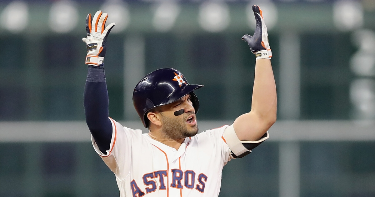 Jose Altuve of the Houston Astros reacts at second base after being called out due to fan interference in the first inning against the Boston Red Sox on Wednesday.