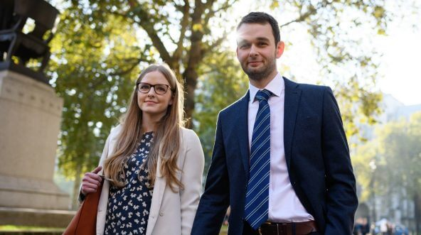 Bakery owners Amy and Daniel McArthur, who own 'Ashers' in Belfast, walk away from the Supreme Court after winning their appeal against a gay rights campaigner who took the business to court after they refused to make a cake, promoting same-sex marriage, on Oct. 10, 2018, in London, England.