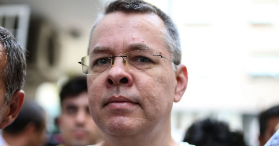 Rev. Andrew Brunson is escorted by Turkish authorities from a prison to house arrest.