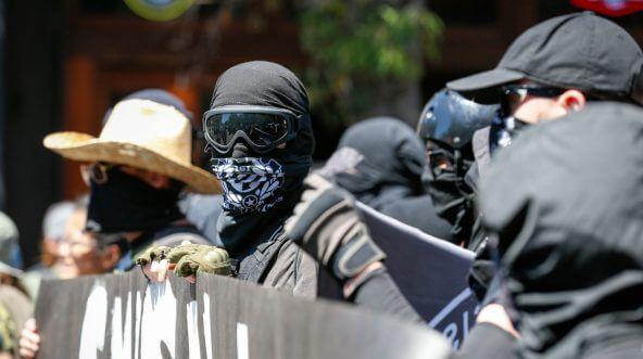 Antifa militants march with counter protesters