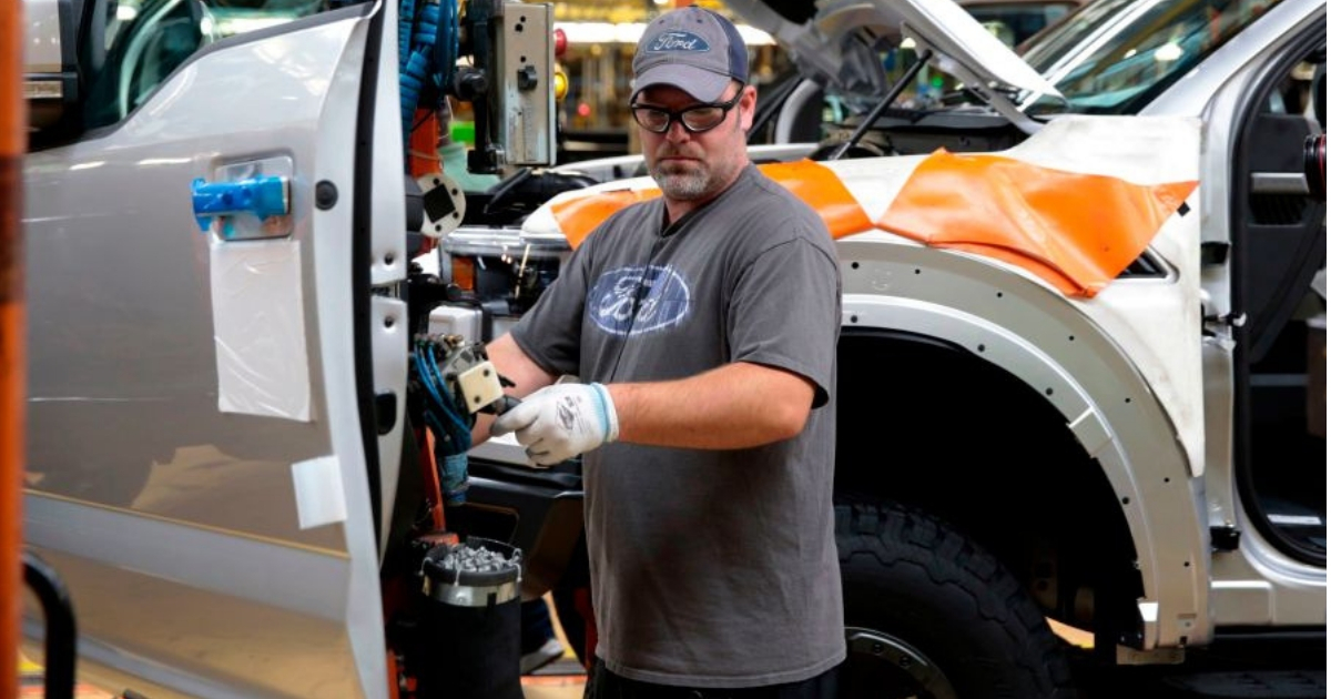 An employee works on the assembly line for the Ford 2018 and 2019 F-150 truck at the Ford Motor Company's Rouge Complex in Dearborn, Michigan.