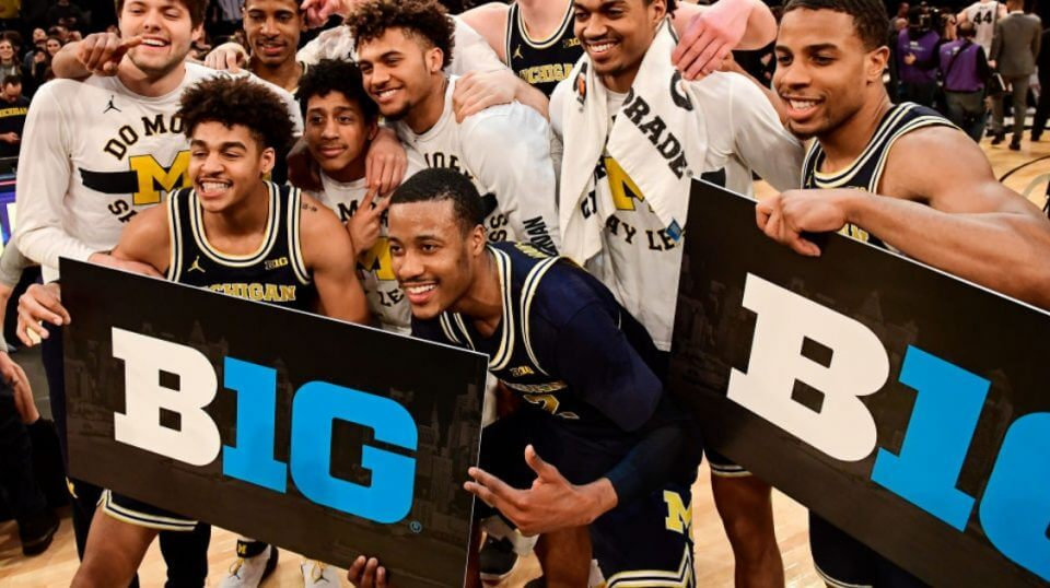 The Michigan Wolverines celebrate a win over the Purdue Boilermakers in the championship game of the 2018 Big Ten Basketball Tournament at Madison Square Garden.
