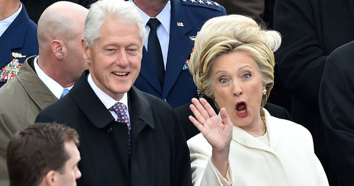 Former President Bill Clinton and former first lady Hillary Clinton wave to friends while attending the inauguration of President-elect Donald Trump in January 2017.