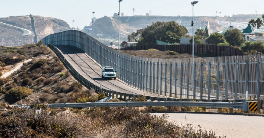 A Border Patrol vehicle cruises the U.S.-Mexico border between San Diego, California, and Tijuana, Mexico.