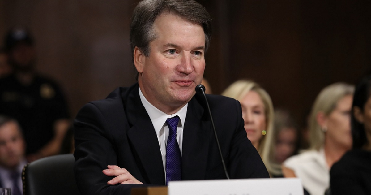 Supreme Court nominee Brett Kavanaugh is pictured at the table during his hearing before the Senate Judiciary Committee on Sept. 27.