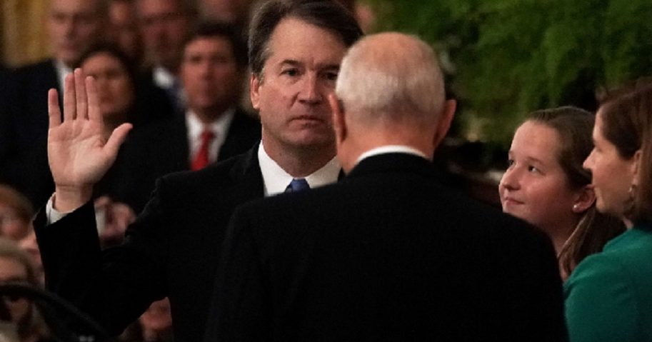 Supreme Court Justice Brett Kavanaugh is sworn in by retired Justice Anthony Kennedy at the White House on Oct. 8.