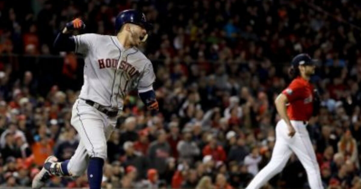 Houston's Carlos Correa celebrates after his sixth-inning RBI single against the Boston Red Sox during Game 1 of the American League Championship Series on Saturday.