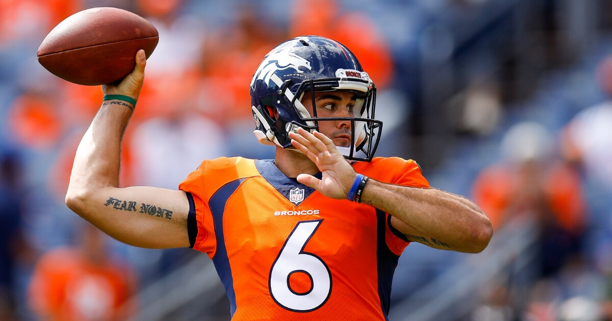 Quarterback Chad Kelly of the Denver Broncos warms up before a game against the Oakland Raiders at Mile High on Sept. 16.