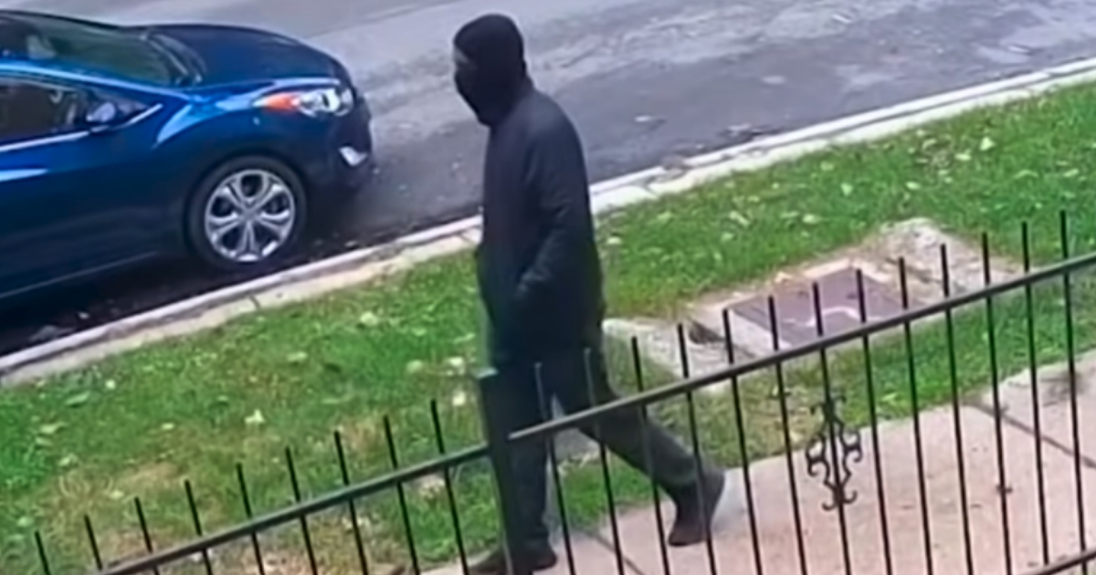 Chicago police have released images of a masked individual who is believed to have killed two people.