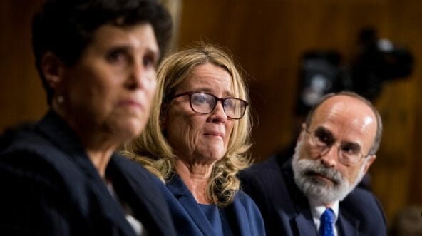 Christine Blasey Ford, center, is flanked by attorneys Debra Katz, left, and Michael Bromwich during her testimony before the Senate Judiciary Committee hearing on the Supreme Court nomination of Brett Kavanaugh.
