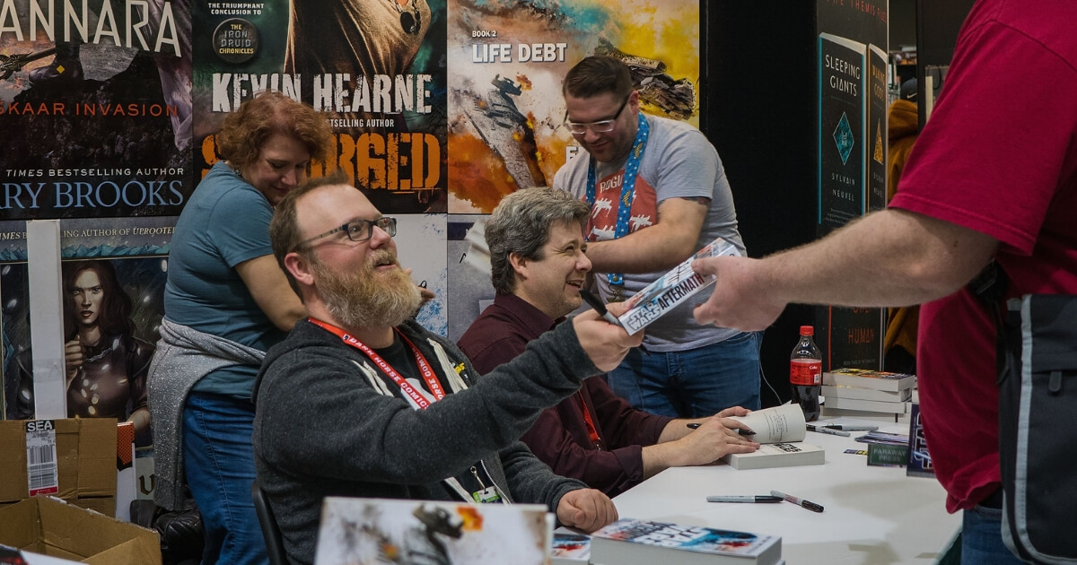 Author Chuck Wendig signs copies of his book