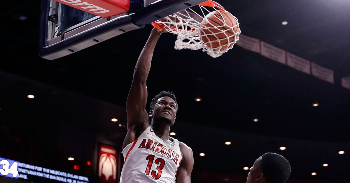 DeAndre Ayton of the Arizona Wildcats dunks during a 2017 game against Arizona State.