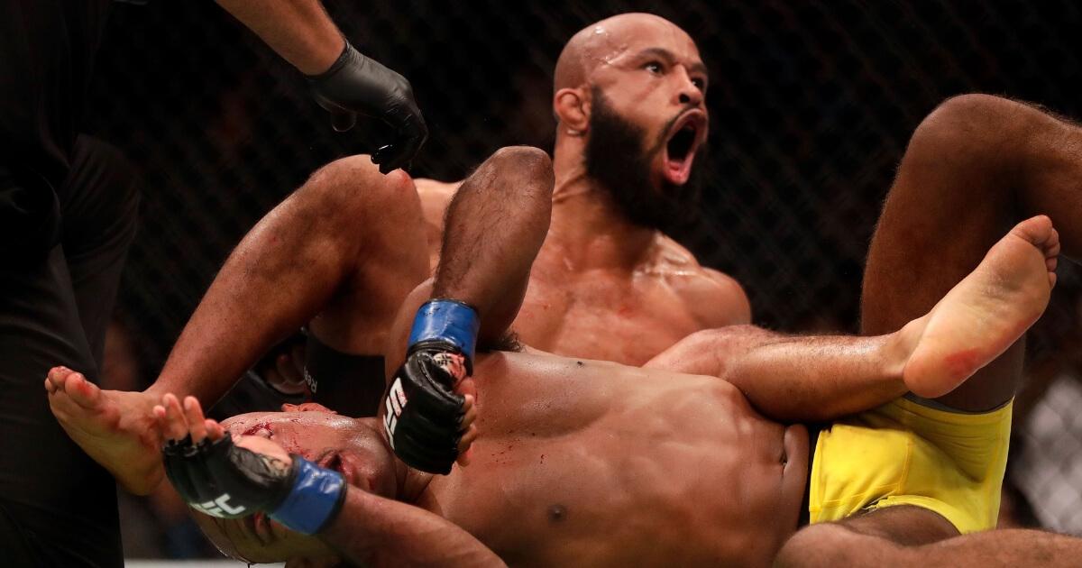 Demetrious Johnson celebrates as he defeats Wilson Reis in their championship bout on UFC Fight Night on April 15, 2017, in Kansas City, Missouri.