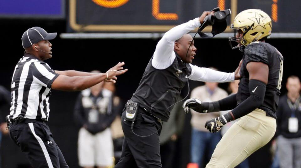 Vanderbilt head coach Derek Mason pushes defensive lineman Dayo Odeyingbo (10) off the field during a confrontation between Vanderbilt and Florida in the first half of Saturday's game in Nashville, Tennessee.
