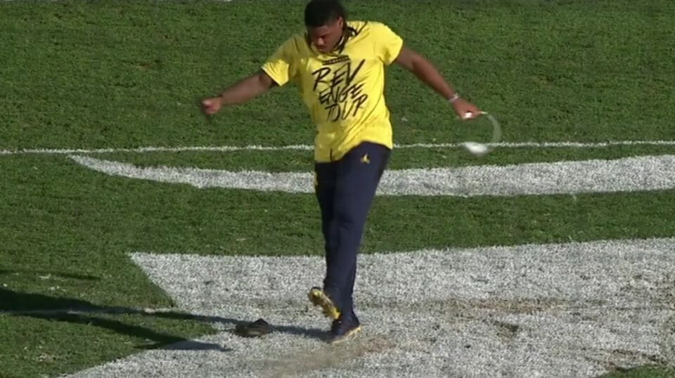 Michigan's Devin Bush Jr. defaces the Michigan State Spartans' logo at midfield before the rivals' game Saturday.