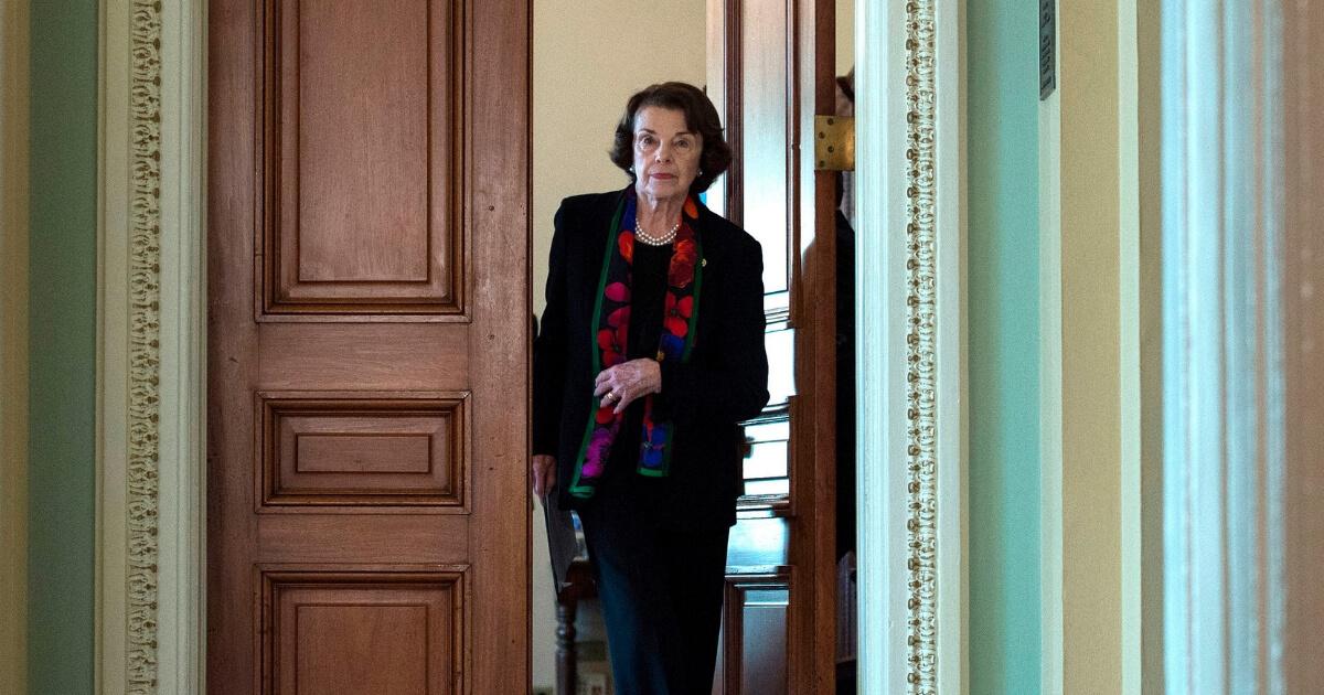 Democratic US Senator Dianne Feinstein walks to a press briefing