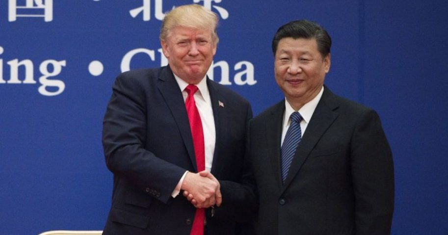 President Donald Trump and China's President Xi Jinping shake hands in Beijing in 2017.