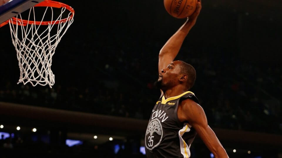 Kevin Durant of the Golden State Warriors dunks against the New York Knicks at Madison Square Garden on Friday.