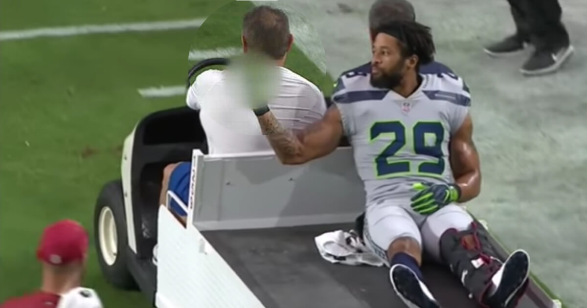 Seattle's Earl Thomas gives a middle-finger gesture toward the Seahawks sideline after leaving the field with an injury Sunday at Arizona.