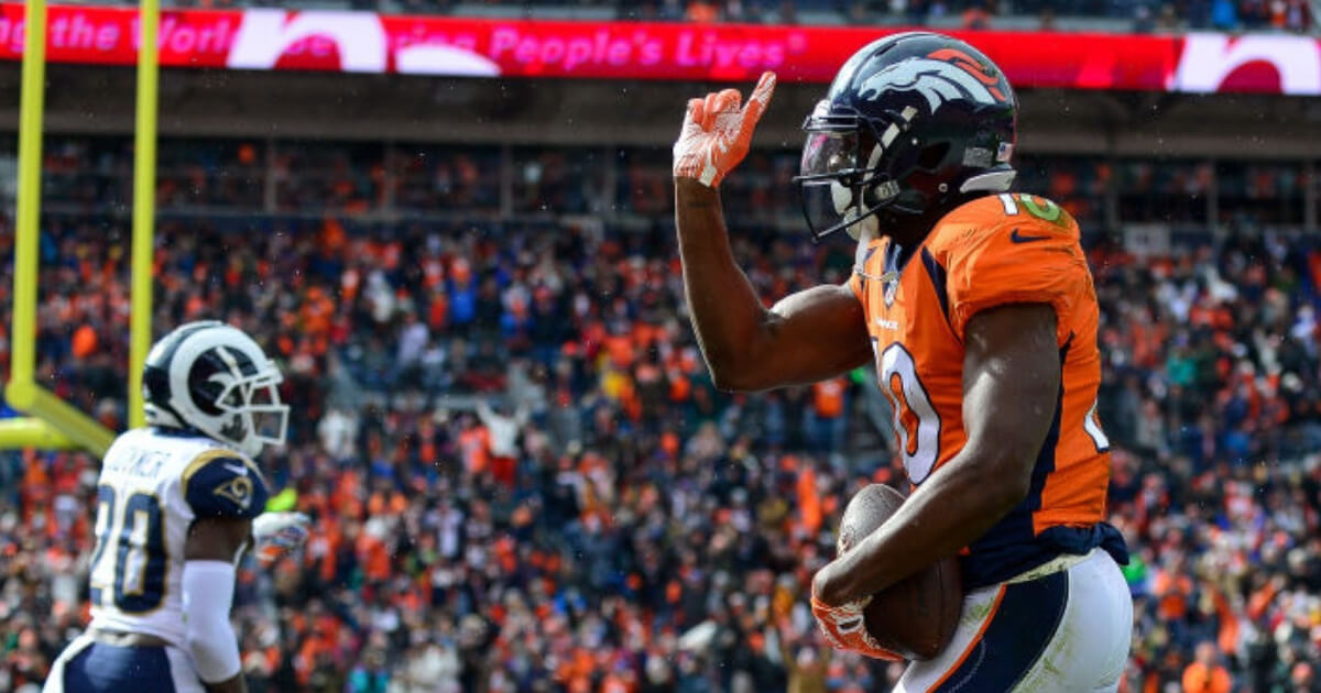 Denver wide receiver Emmanuel Sanders points his finger at a Los Angeles Rams defender after nearly scoring a touchdown. He was penalized 15 yards for taunting.