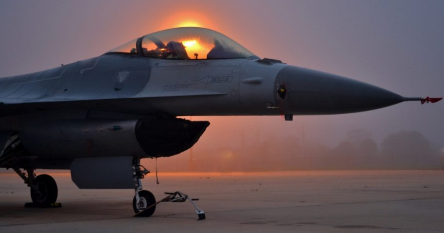An Air Force F-16 Viper - Fighting Falcon waits on a runway in Melbourne, Florida.