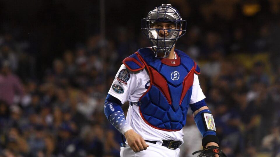 Yasmani Grandal of the Los Angeles Dodgers looks on during a rough night Monday against the Milwaukee Brewers in Game 3 of the National League Championship Series. Many of the fans at Dodger Stadium booed the catcher.