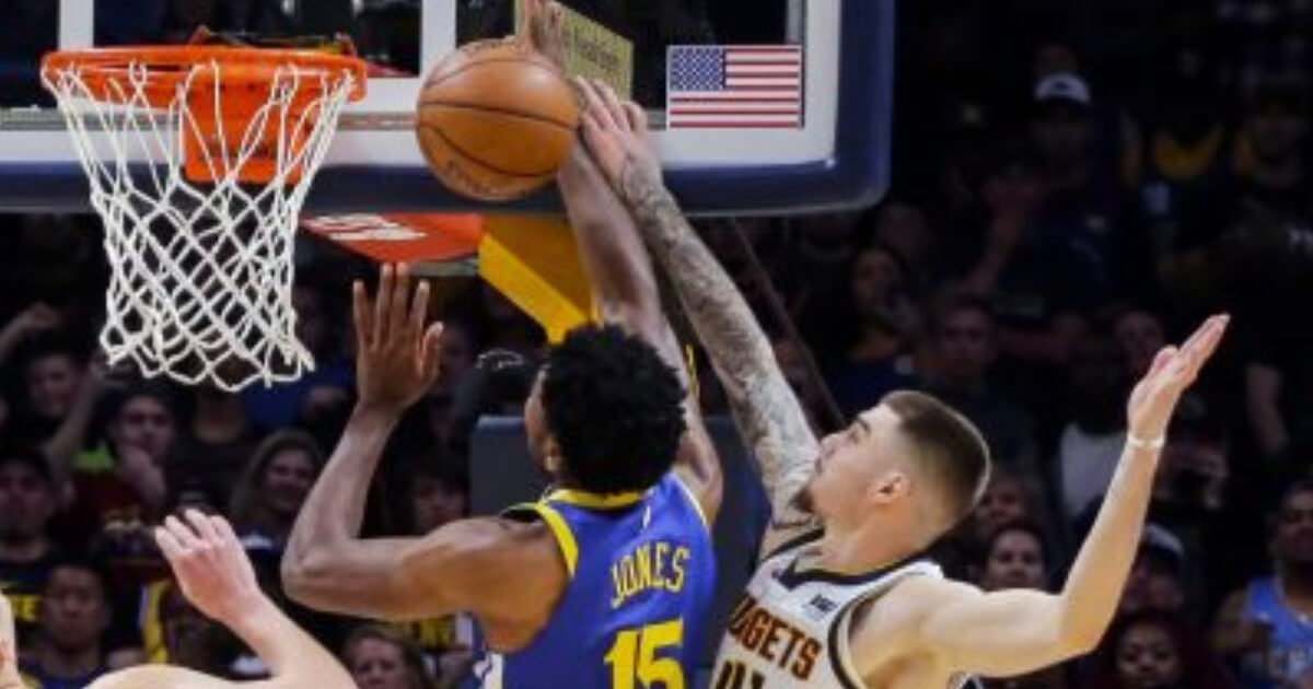 Denver Nuggets forward Juancho Hernangomez (41) blocks a shot by Golden State Warriors center Damian Jones (15) in the final seconds of Sunday's game in Denver. The Nuggets beat the Warriors 100-98.