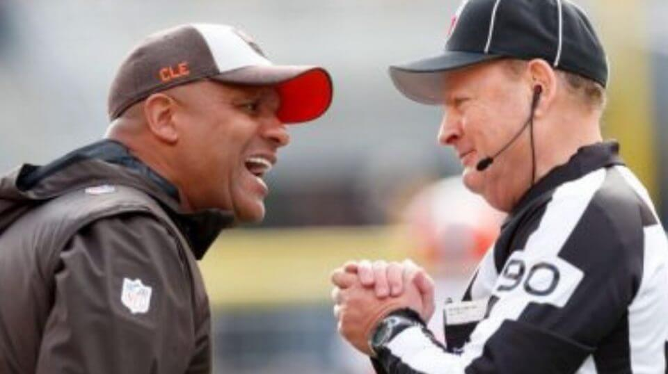 Cleveland Browns head coach Hue Jackson, left, talks with an official during Cleveland's loss at Pittsburgh on Sunday.