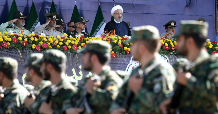 Iran's President Hassan Rouhani reviews army troops marching during the 38th anniversary of Iraq's 1980 invasion of Iran, in front of the shrine of the late revolutionary founder, Ayatollah Khomeini, outside Tehran, Iran, Saturday, Sept. 22.