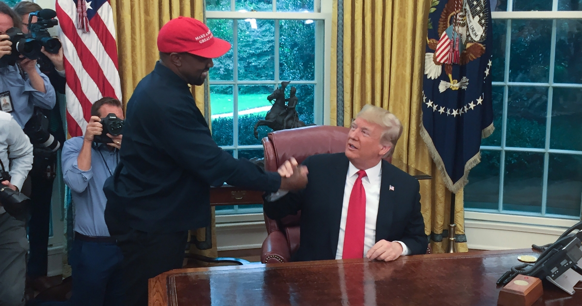 U.S. President Donald Trump meets with rapper Kanye West in the Oval Office.