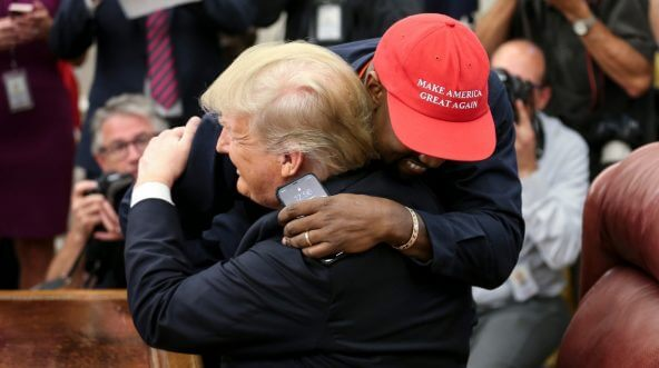 Rapper Kanye West hugs President Donald Trump during a meeting in the Oval Office of the White House on Thursday.