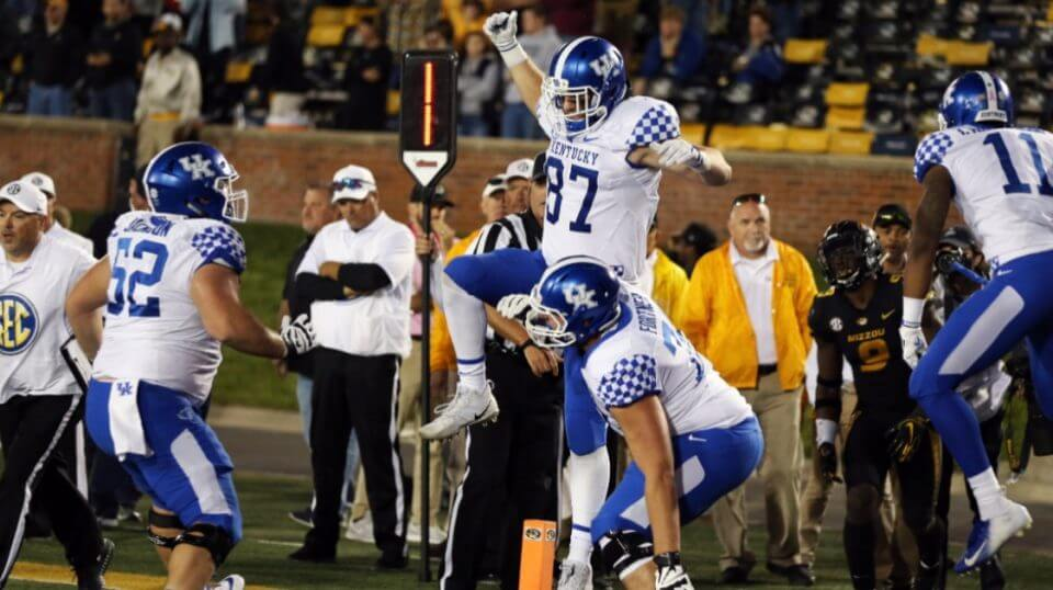 Tight end C.J. Conrad (87) celebrates with his teammates after catching the game-winning pass on the final play of Kentucky's 15-14 win at Missouri on Saturday.