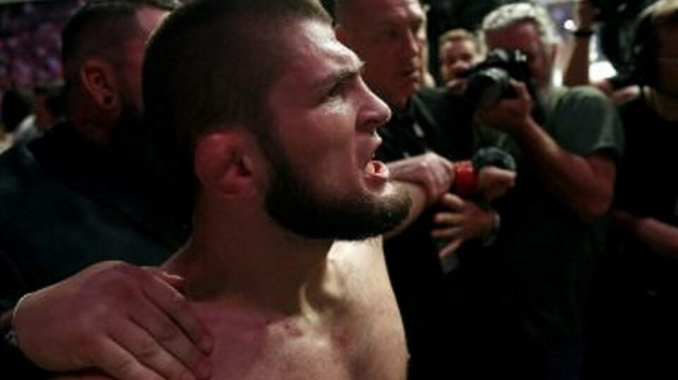 Russian UFC fighter Khabib Nurmagomedov is held back outside of the cage after beating Conor McGregor in a lightweight title mixed martial arts bout at UFC 229 in Las Vegas on Oct. 6.