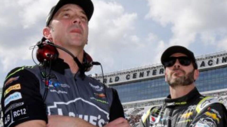 Crew chief Chad Knaus, left, and Jimmie Johnson watch the leaderboard during qualifying for the Daytona 500 in February.