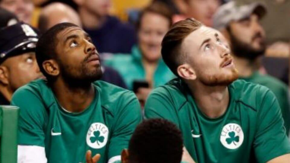 Boston Celtics Kyrie Irving, left, and Gordon Hayward look on from the bench during a 2017 game. With both players healthy, Boston is considered the presumptive favorite in the Eastern Conference.