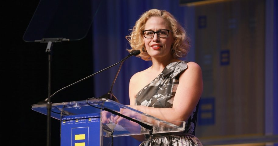 Congresswoman Kyrsten Sinema speaks onstage