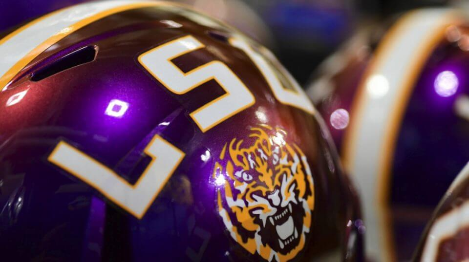 The helmets with LSU's 2018 uniform change color from purple to gold under the stadium lights.