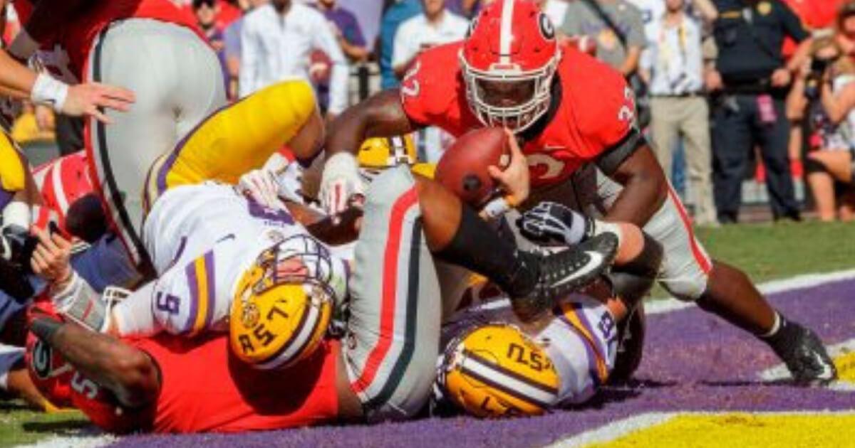 LSU quarterback Joe Burrow (9) scores a touchdown against visiting Georgia on Saturday.