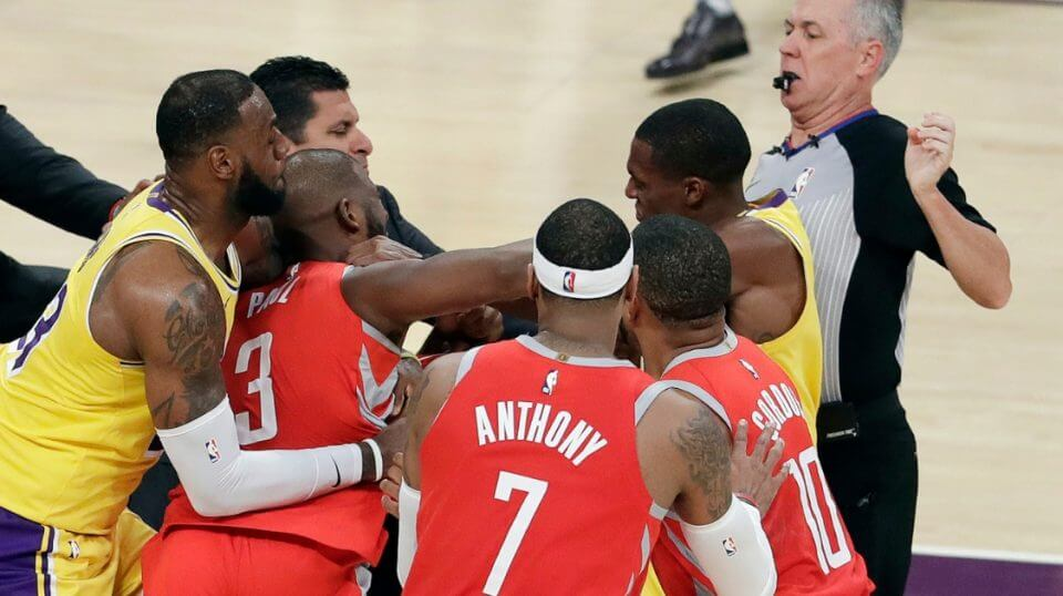 Chris Paul, second from left, is held back by LeBron James, left, as Paul fights with Lakers guard Rajon Rondo, center obscured, during the second half of Saturday's game in Los Angeles.