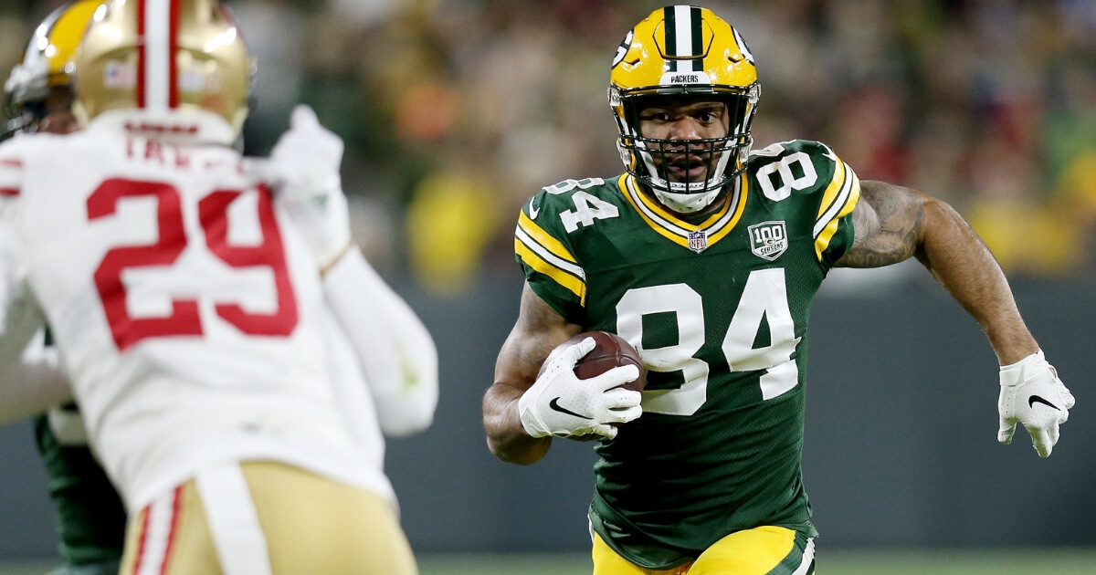 Lance Kendricks of the Green Bay Packers runs with the ball in the first quarter Monday night against the San Francisco 49ers at Lambeau Field.
