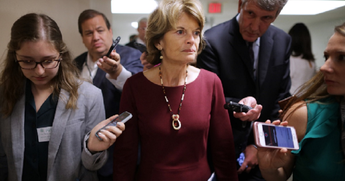 Alaska Sen. Lisa Murkowski makes her way to a weekly Republican luncheon last week at the Capitol.
